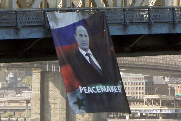 oct-07-vladimir-putin-banner