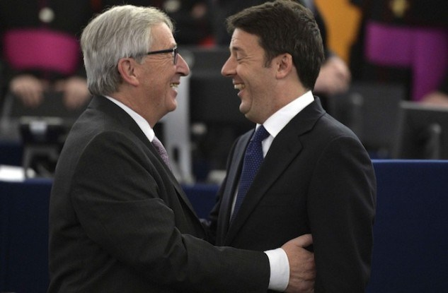 Italian Prime Minister Matteo Renzi talks with European Commission President Luxembourg Jean-Claude Juncker before the arrival of Pope Francis at the European Parliament in Strasbourg